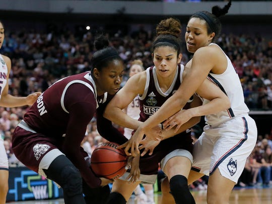 Connecticut forward Napheesa Collier, right, battle Mississippi State forward Breanna Richardson, left, and guard Dominique Dillingham, center, battle for control of the ball during the first half of an NCAA college basketball game in the semifinals of the women's Final Four, Friday, March 31, 2017, Friday, March 31, 2017, in Dallas. (AP Photo/Tony Gutierrez)