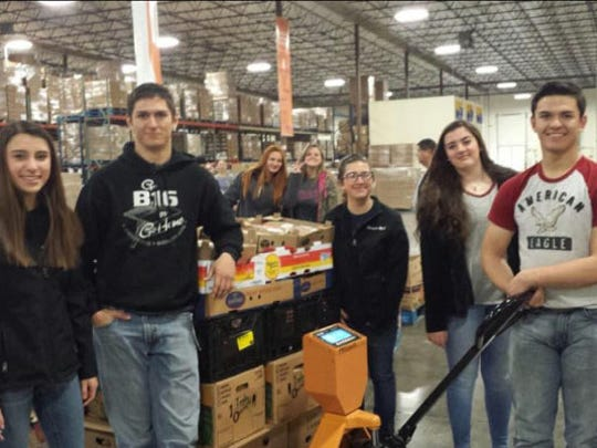 The Capitan FFA chapter officer team, pictured, from left; Adrianna Romero, Wade Stearns, Maggie Rich, Shelby Southard, and Clay Bob Stearns are seen here at a volunteer event at the Roadrunner Food Bank that supplies food for 90 percent of New Mexico's hungry by donating food to communities all around New Mexico.
