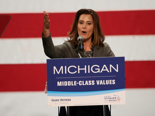 Michigan Senate Democratic Leader Gretchen Whitmer speaks during the Michigan Democratic Party Campaign rally with special guest First Lady Michelle Obama in 2014.