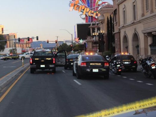 Washoe County deputies and Reno police block off South Virginia Street between Hubbard Way and the entrance of the Peppermill Resort Spa Casino on Aug. 31, 2014. Police shot a suspect following a robbery at a CVS Pharmacy at Shoppers Square in Reno.