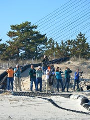 A group of birdwatchers looks for and spots sea birds at Indian River Inlet on Saturday.