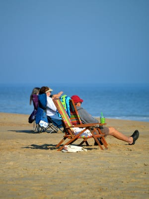 Mike Lee, of Arlington, Va., relaxes on Rehoboth Beach on Saturday.