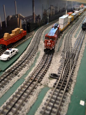 A model freight train makes its way around the oval. The Delaware SeaSide Rail Road Club brought their layout to the Georgetown Public Library for the holiday season.