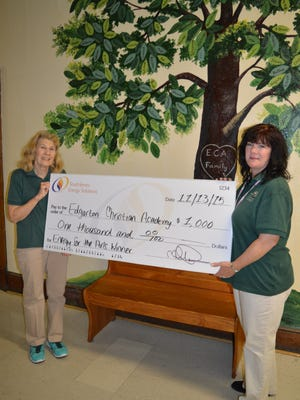 Art teacher Irene Anderson (left) and music teacher Karen Jeffers of Edgarton Christian Academy in Newfield pose for a photo after being presented with a $1,000 grant from South Jersey Energy.