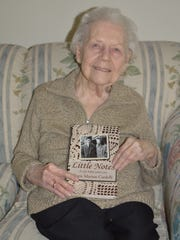 Doris Cardelli, 92, of Royal Oak with her memoir.