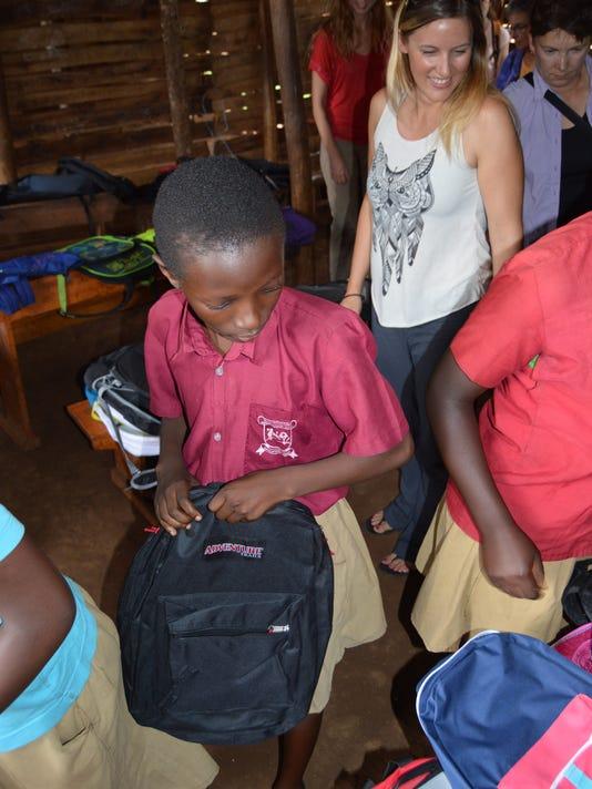 kids-selecting-backpack-with-Kiana-Lucero.JPG