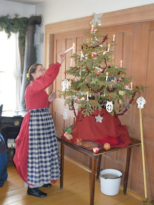 The Wade House stagecoach hotel will be decorated in traditional Christmas splendor with fresh evergreen garlands and a candlelit Christmas tree.