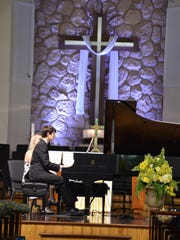 Fifteen-year-old Andrew Miller performs at Christ by