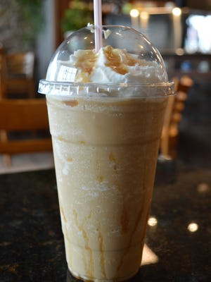 The most popular drink at San Laurio Coffeehouse is a blended caramel macchiato. It's made withsoft serve, espresso, caramel and vanilla syrups, and ice for$4.95.