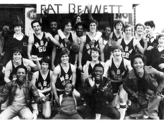 1980 photo of MBA basketball team from the school yearbook. The team posed outside North Nashville restaurant Fat Bennett because their coach's name was Johnny Bennett. The player in the first row, far left, is Ricky Bowers.