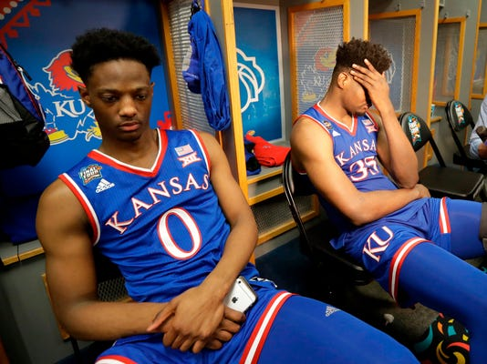 Kansas's Marcus Garrett (0) and Udoka Azubuike (35) react in the locker room after the semifinals of the Final Four NCAA college basketball tournament against Villanova, Saturday, March 31, 2018, in San Antonio. Villanova won 95-79. (AP Photo/Eric Gay)