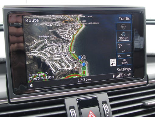 Audi A6 has a flip-up navigation screen with a cool