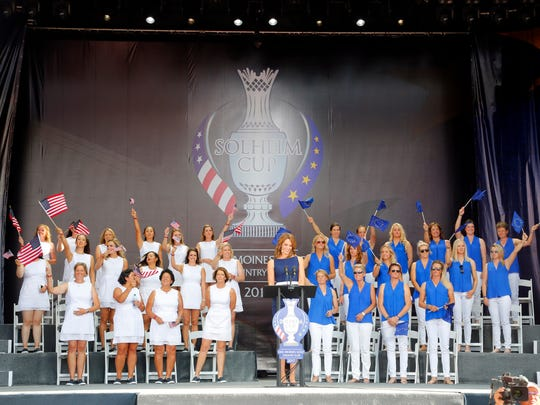 The United States and European teams take the stage during the opening ceremony for the 2017 Solheim Cup Thursday, Aug. 17, 2017.