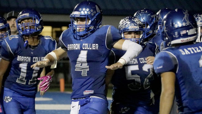 Quarterback, Jack Bueltel (4), celebrating his touchdown with his teammates during the 4th quarter.