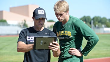 Fort Collins High School track and field coach Conrad Crist, left, works with former Lambkin Hunter Powell. Crist was named the USTFCCCA's Colorado Coach of the Year on Tuesday.