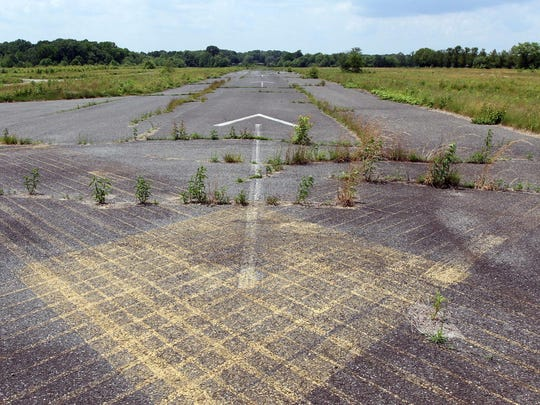 The abandoned runway at the former Marlboro Airport is shown Tuesday, June 9, 2015. It was to be the site of a massive senior housing complex until the FBI busted corruption in town in 2005.