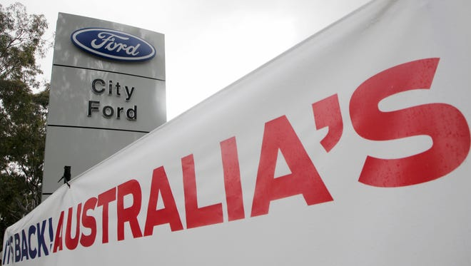 In this May 23, 2013, file photo, a banner is displayed at a Ford dealership in Sydney. Ford Motor Co.'s Australian subsidiary was fined 10 million Australian dollars ($7.6 million) by an Australian court on Thursday, April 26, 2018,  for mishandling customer complaints about faulty automatic transmissions in thousands of cars.