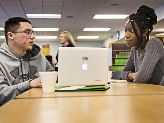 Senior Tajohnie Milton, right, works with freshman Hunter Buckling during an Advanced Placement language class in 2016.