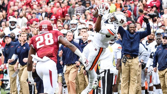 Receiver Ricardo Louis caught six passes for 79 yards, but had a key drop in the end zone in Auburn's 54-46 loss overtime loss at Arkansas.