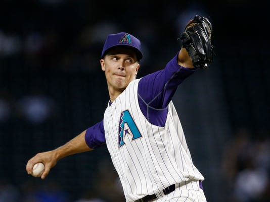 Arizona Diamondbacks' Zack Greinke throws a pitch against the Los Angeles Dodgers during the first inning of a baseball game Thursday, Aug. 31, 2017, in Phoenix. (AP Photo/Ross D. Franklin)