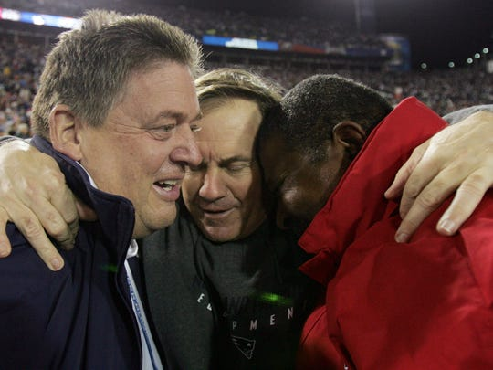 "FILE - In this Feb. 6, 2005 photo, New England Patriots offensive coordinator Charlie Weis, left, head coach Bill Belichick, and defensive coordinator Romeo Crennel, right, celebrate after the Patriots beat the Philadelphia Eagles, 24-21 in Super Bowl XXXIX in Jacksonville, Fla.    Notre Dame fired coach Charlie Weis on Monday, Nov. 30, 2009  after a string of disappointing seasons that was capped by an agonizing four-game losing streak. Athletic director Jack Swarbrick announced the decision, saying in a news release: ""We have great expectations for our football program, and we have not been able to meet those expectations.""  (AP Photo/David J. Phillip)"