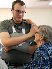 """Robert """"Caleb"""" Engle, left and Muriel Luker talk after church service on Oct. 1, 2017, a week after he was injured during a shooting at the church . Luker and Engle were at the church during the shooting last Sunday.  Engle """"physically engaged"""" with the suspect, helping to stop the shooting, Nashville police said."""