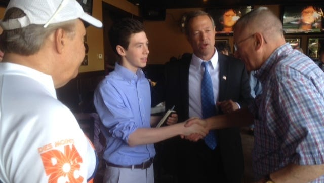 Maryland Gov. Martin O'Malley, second from right, introduces his son, Will O'Malley, to Iowa Democrats during a visit to central Iowa on June 21.