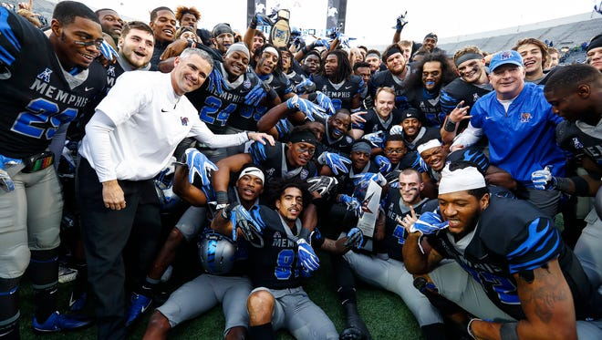 Memphis teammates celebrate their 66-45 victory over SMU in Memphis, Tenn., Saturday, November 18, 2017. The win gives the Tigers their first AAC West Division Championship.