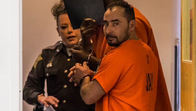 Manuel Orrego-Savala, charged with two counts of failure to remain at the scene of an accident, a Level 3 felony, and two counts tied to drunken driving death, a Level 4 felony, walks out of the courtroom at the City-County Building on Feb. 7, 2018.