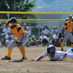 CMR''s Courtney Schroeder reaches for a tag as a Missoula Big Sky baserunner dives safely back into first base.