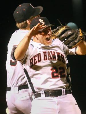 Stewarts Creek pitcher Austin Steel (22) and Dylan Burney (5) jump up and slam into each other as they celebrate their win over Siegel on Wednesday, April 13, 2016.