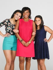 Denita Arnold and daugthers Mikayla, left, and Mia, right. May 8, 2014