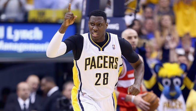 INDIANAPOLIS, IN - MAY 07:  Ian Mahinmi #28 of the Indiana Pacers celebrates after making a basket against the Washington Wizards in Game 2 of the Eastern Conference Semifinals during the 2014 NBA Playoffs at Bankers Life Fieldhouse on May 7, 2014 in Indianapolis, Indiana. NOTE TO USER: User expressly acknowledges and agrees that, by downloading and or using this photograph, User is consenting to the terms and conditions of the Getty Images License Agreement.  (Photo by Andy Lyons/Getty Images)