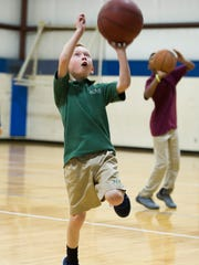 Warren Phelps, 9, of Henderson, shoots a basket in the youth gym at the Henderson County Family YMCA, Tuesday, Jan. 24. 2017. In 2016, the Henderson County Family YMCA offered financial assistance services to 3,874 people for a value of $421,758.