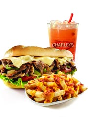 A philly cheese steak, cheese and bacon gourmet fries and strawberry lemonade at Charleys.