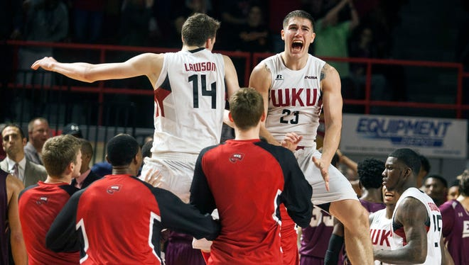 Western Kentucky forward Ben Lawson (14) and forward Justin Johnson (23) celebrate after an NCAA college basketball game against Eastern Kentucky, Tuesday, Dec. 1, 2015, in Bowling Green, Ky. (Austin Anthony/Daily News via AP) MANDATORY CREDIT