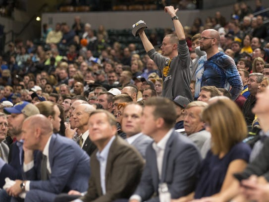 Pacers fans yell toward the court near the end of a