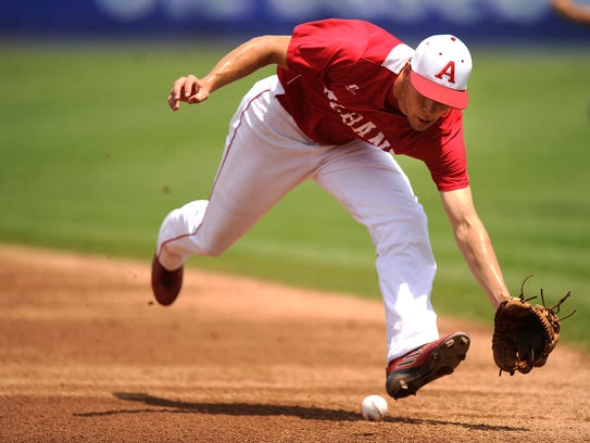 Albany second baseman Hunter Owen (8) attempts to field