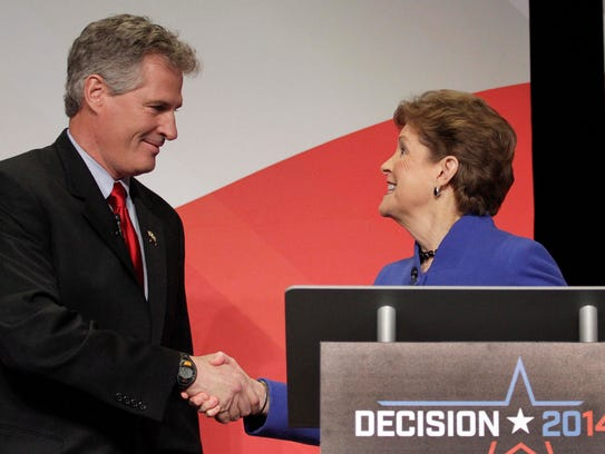Sen. Jeanne Shaheen greets Republican challenger Scott