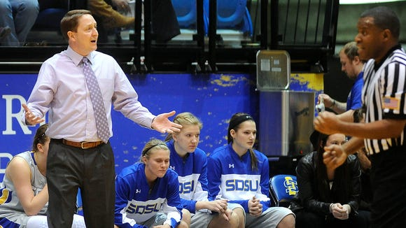 SDSU head coach Aaron Johnston disagrees with a referee during women's basketball action against Green Bay at Frost Arena in Brookings, S.D., Wednesday, Dec. 10, 2014.