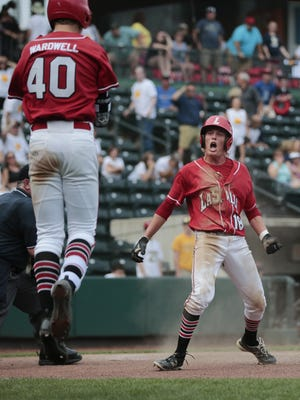 La Salle's Brady Reynolds, right, and Tyler Wardwell (40), left, celebrate the walk-off win against Solon during the OHSAA Division I state semifinal game between the La Salle Lancers and Solon, Thursday, June 2, at Huntington Park in Columbus, Ohio.