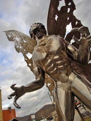 "** FOR IMMEDIATE RELEASE ** A large Mothman sculpture stands along Main Street Tuesday, Dec. 11, 2007 in Point Pleasant, W.Va. More than 40 years after the first reported sighting of the mysterious creature later dubbed ""Mothman,"" residents here have embraced his legend, helping to turn the town into a destination for people in search of an offbeat tourism experience. (AP Photo/Jeff Gentner) ORG XMIT: NY406"