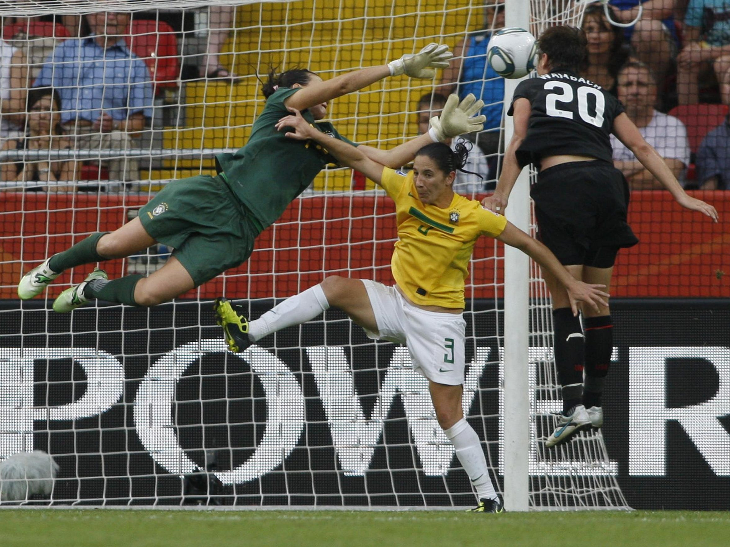 Abby Wambach leaps to head in a dramatic goal off a Megan Rapinoe cross in extra time against Brazil in the World Cup quarterfinals in Germany in 2011.