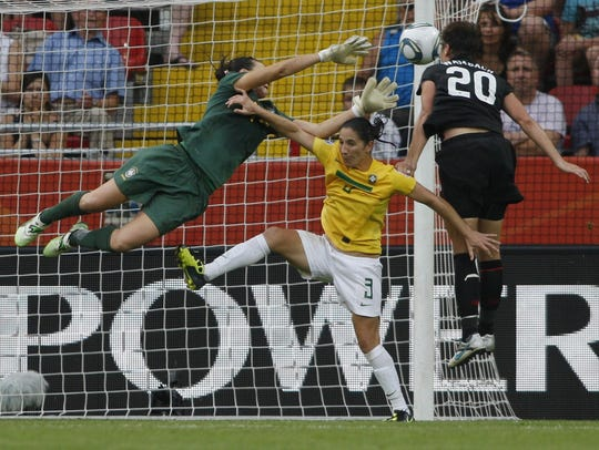 Abby Wambach leaps to head in a dramatic goal off a