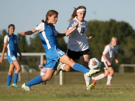 Chester County's Anslee West (15) connects with the