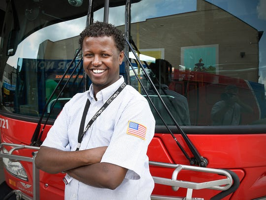 MetroBus driver Mohamed Hussein transfers passengers at the Transit Center Wednesday, Aug. 3, 2016, in St. Cloud.