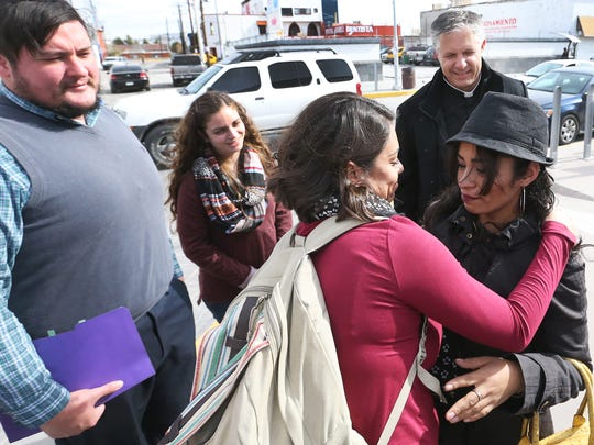 Rosa Mani Arias, right, on Tuesday is greeted by Johana Bencomo of New Mexico Communities in Action and Faith, an immigrant rights group, and members of the Sonoma Springs Covenant Church of Las Cruces two blocks south of the Paso del Norte Bridge in Juárez. From left are Pastor Robert Frick, church member Angelina Della Rocco and lead Pastor Roberto Reed.