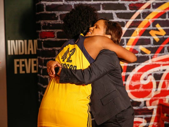 Indiana Fever head coach Pokey Chatman gets a hug from