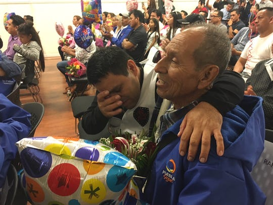 Filemon Benitez, 46, wipes a tear from his eye after he reunites with his father, Rafael Benitez, 78, who traveled from Mexico to Passaic as part of reunification program organized by Mi Casa es Puebla.