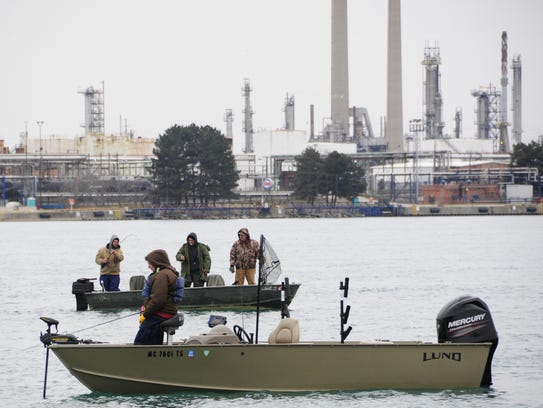 Anglers fish for walleye and other fish species in